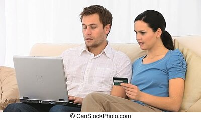Lovely couple buying something on the internet