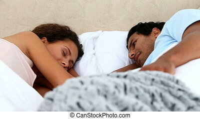 Lovely couple discussing in bed in the morning