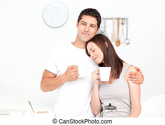 Lovely couple drinking coffee during breakfast in the...