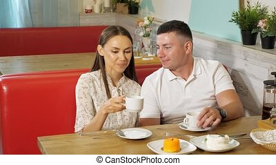lovely couple drinks tea having date in confectionery shop