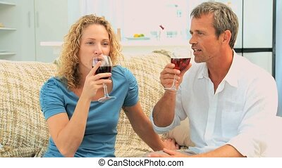 Lovely couple enjoying a red wine