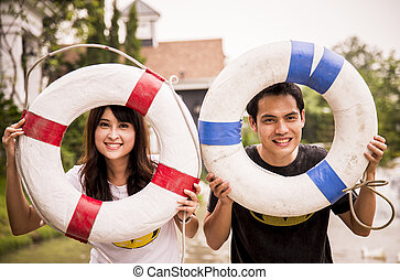 Lovely couple hold the life ring on the port3