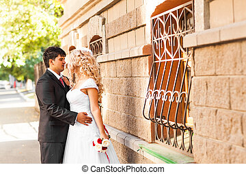 Lovely couple in love kissing each other on the day of a wedding