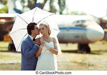 Lovely couple in the sunny wedding day