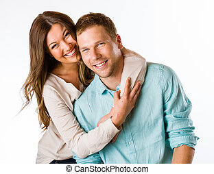 Lovely couple - Lovely attractive couple hugs together, ...