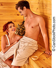 Lovely couple relaxing at sauna. Two persons.