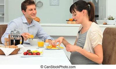 Lovely couple taking the breakfast