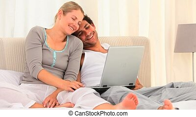 Lovely couple using a laptop