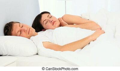 Lovely couple waking up