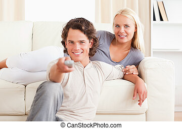 Lovely couple watching the television