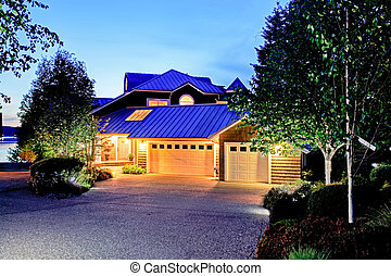 Lovely curb appeal of large luxury house with blue roof. ...