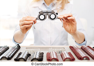 Lovely diligent optician suggesting trial spectacles