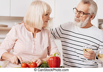 Lovely elderly couple cooking in the kitchen