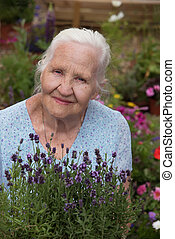 Elderly Woman Holding Lavender