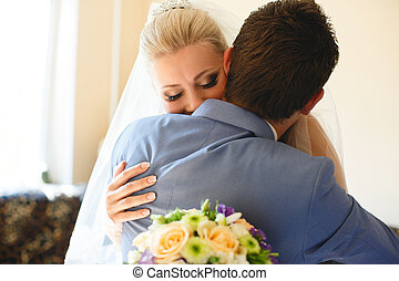 Lovely embracement of the couple in their wedding day