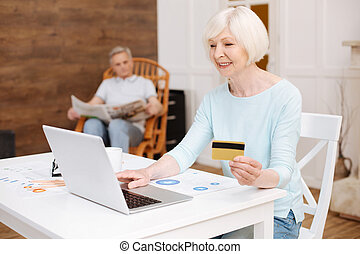 Lovely enthusiastic lady shopping online