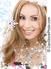 lovely fairy in crown with magic wand