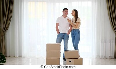 couple wearing jeans plans furniture location in new house