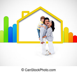 Lovely family standing with a yellow house illustration with energy rating symbol on the white background