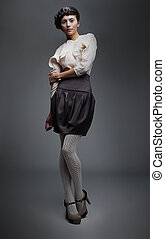 Lovely fashion model girl in retro black skirt, white shirt
