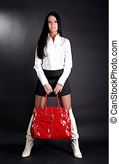 lovely fashion model with red bag