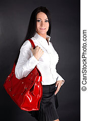 lovely fashion woman with red bag