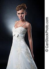 Lovely fiancee fashion model posing. Studio shot