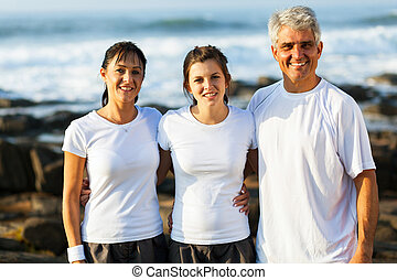 fit family at the beach after exercising