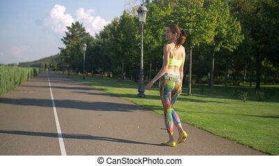 Lovely fitness woman relaxing after jogging