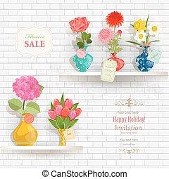 lovely flowers in modern vases for sale on shelves in a store