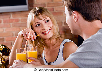 Photo of a beautiful amorous woman listening to the man