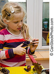 lovely girl active with scissors