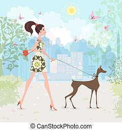 Lovely girl and her dog are walking in the city.