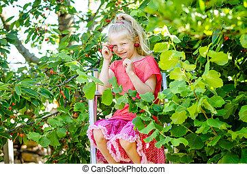lovely girl eating cherry fruit