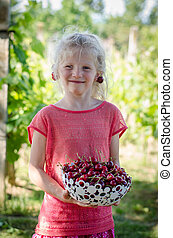 lovely girl holding basket with cherry