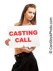 lovely girl holding casting call board