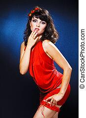 lovely girl in red dress over black