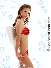 girl in red lingerie with angel wings and snowflakes