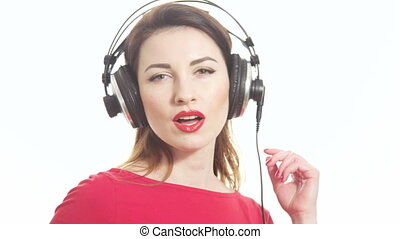 Lovely girl in red listening