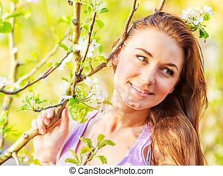 Lovely girl in spring park