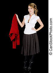 A cute young woman is removing her sweater. Isolated on Black.