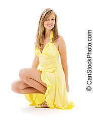 lovely girl in yellow dress over white