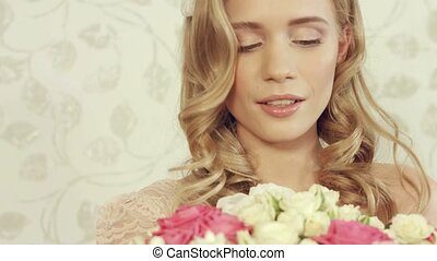 Lovely girl is happy that she has received a huge bouquet