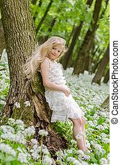 lovely girl posing in spring forest