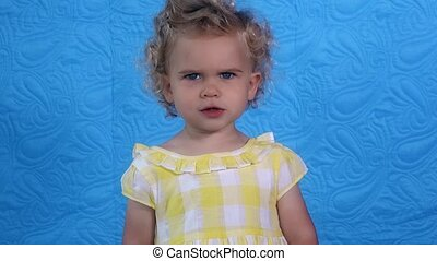 Lovely girl showing various emotions at camera. Sad happy angry child face