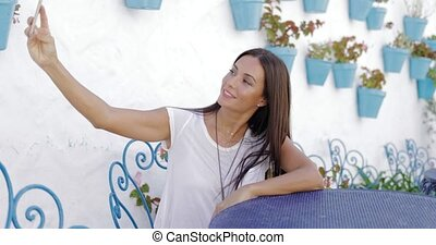 Lovely girl taking selfie at table