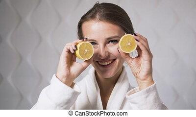 Lovely Girl with Lemon - Lovely, smiling girl having fun...