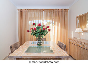 Lovely hall., interior room. With a bouquet of roses on the table.
