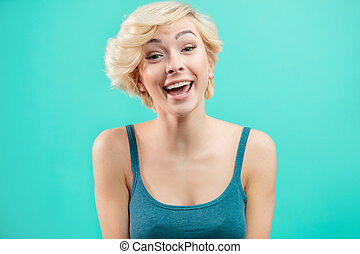 lovely hipster girl with short fair hair having fun.