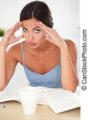 Lovely hispanic adult female looking stressed